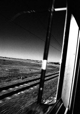 Alexandra Murphy passing landscape from train window, karoo, south africa, december 1996 � alexandra c murphy www.acm-photo.com Railways/Trains