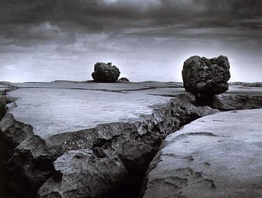 Vincent MacNamara BOULDERS ON TO ROCKY LANDSCAPE Rocks/Mountains