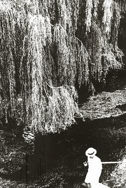 David Gibson MAN IN BOAT UNDER TREE Men