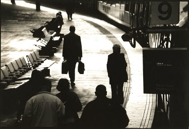 Graham Hunt COMMUTERS AT STATION Groups/Crowds