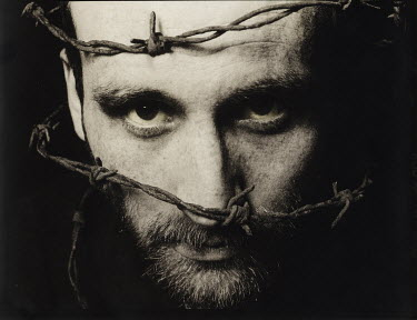 Graham Hunt MAN WITH BARBED WIRE OVER FACE Men