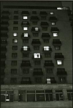 Denis Cohadon FIGURE IN WINDOW OF LARGE BUILDING Miscellaneous Buildings
