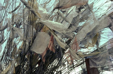 Bruce Chatwin CLOSE UP OF FRAYED PRAYER FLAGS Miscellaneous Objects