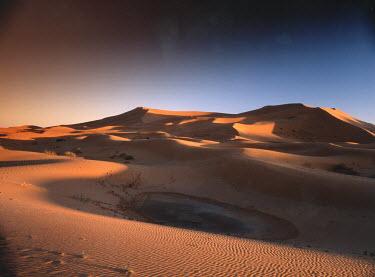 Michael Trevillion SMALL WATER RESERVOIR IN DESERT Desert