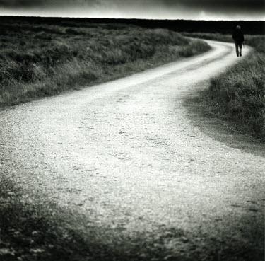 Clint Hughes MAN WALKING ON COUNTRY ROAD Men