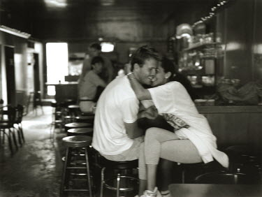 Graham Hughes COUPLE LAUGHING IN DINER Couples