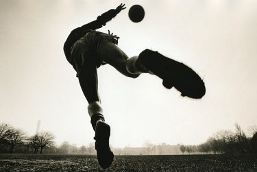 Graham Hughes TEENAGE BOY KICKING FOOTBALL Men