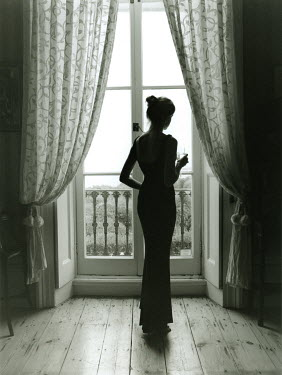 Lesley Aggar WOMAN BY BALCONY DOOR Women