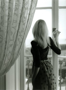Lesley Aggar WOMAN LOOKING OUT OF WINDOW Women