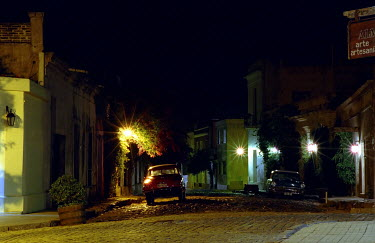 James Goldsmith CAR PARKED IN STREET AT NIGHT Specific Cities/Towns