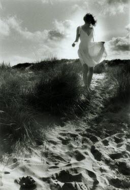 Jon Hatfull WOMAN IN WHITE DRESS ON HILL Women