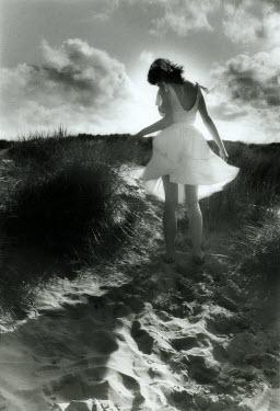 Jon Hatfull WOMAN IN WHITE DRESS ON BEACH Women