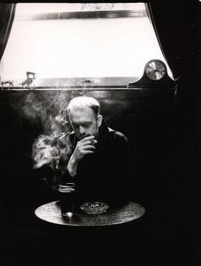Andrew Davis MAN SMOKING IN BAR Men