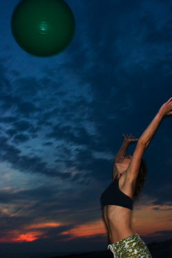Stanislav Solntsev WOMAN PLAYING WITH BEACH BALL Women