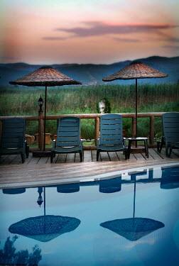 Adrian Muttitt CHAIRS BY POOL Miscellaneous Places