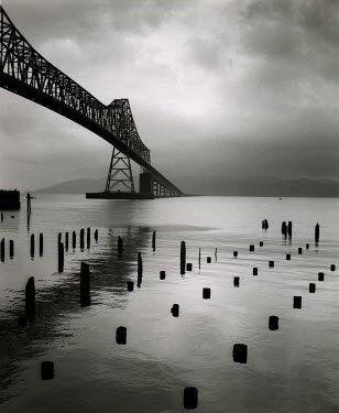 David Henderson BRIDGE WITH POSTS IN WATER Bridges