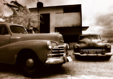Michael Trevillion TWO CLASSIC CARS PARKED OUTSIDE HOUSE Cars