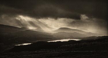 Chris Mowthorpe LIGHT POURING ONTO LAKE AND MOUNTAINS Rocks/Mountains