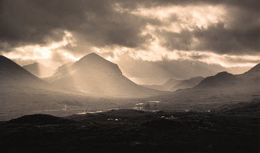 Chris Mowthorpe LIGHT COMING THROUGH CLOUDS ONTO VALLEY Rocks/Mountains