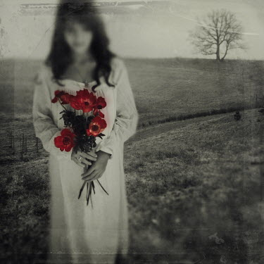 Kamil Vojnar WOMAN STANDING WITH FLOWERS Women