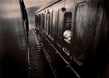 Andrew Sanderson CHILD LOOKING OUT TRAIN WINDOW Children