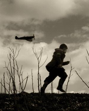 Clayton Bastiani SOLDIER RUNNING WITH PLANE Children