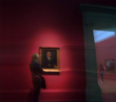 Philip Askew WOMAN LOOKING AT ART IN GALLERY Women