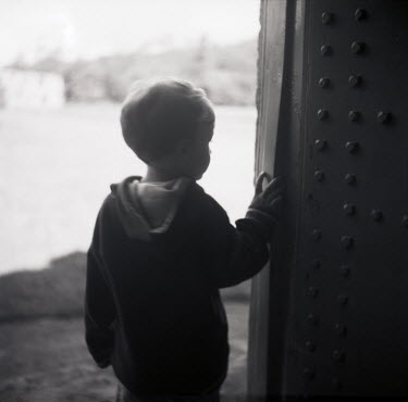 Janet Penny LITTLE BOY IN HOODIE BESIDE WALL OUTSIDE Children