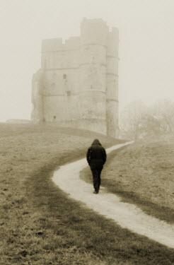 Trevor Payne MAN WALKING ON PATH CLOSE TO TOWER Women