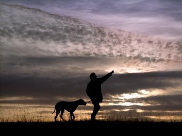 Edward Jones MAN AND DOG IN SILHOUETTE Women