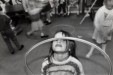 Amanda Harman CHILDREN PLAYING WITH HULA-HOOPS Children