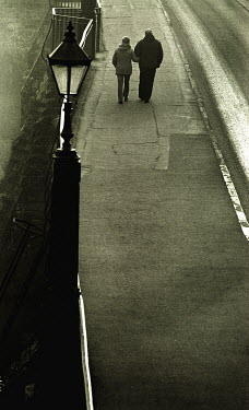 Clint Hughes COUPLE WALKING ON COAST ROAD Couples