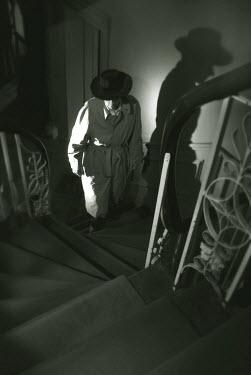 Helen Green MAN ASCENDING STAIRCASE Men
