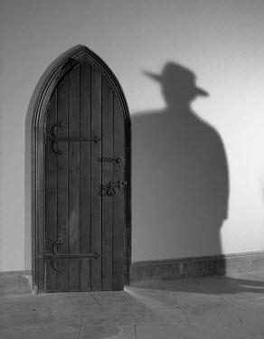 Helen Green SHADOW OF MAN BY WOODEN DOOR Villages