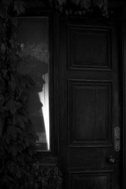 Helen Green SHADOW OF MAN ON DOORWAY Men