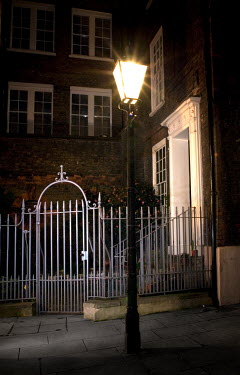 David Foster STREETLAMP AND TOWN HOUSE AT NIGHT Houses