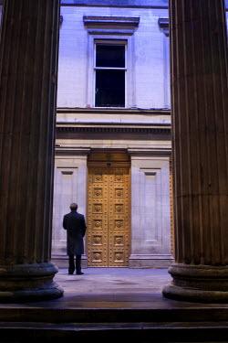 David Foster MAN STANDING BETWEEN STONE COLUMNS Men