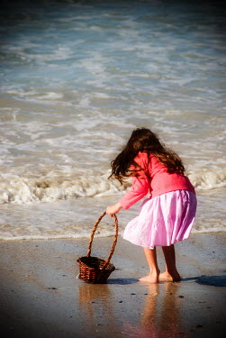 Claire Morgan YOUNG GIRL WITH BASKET ON BEACH Children