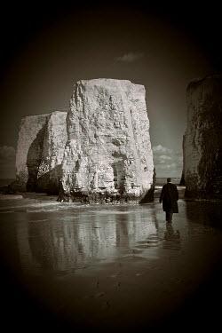 Geoff Eley MAN WALKING ALONG BEACH Men