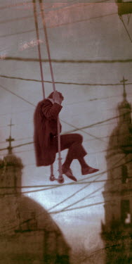Kamil Vojnar MAN SWINGING FROM CABLES IN CITY Men