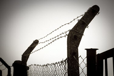 Chris Warren PRISON FENCE WITH BARB WIRE Gates