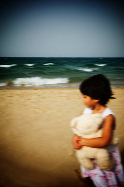 Mohamad Itani CHILD ON BEACH WITH TOY Children