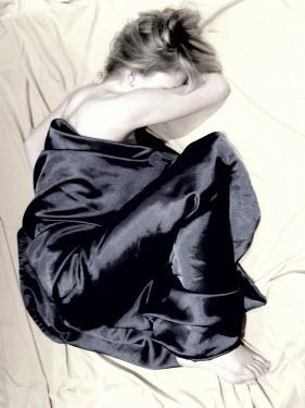 Lena Okuneva WOMAN ON BED WITH BALCK SHEET Women