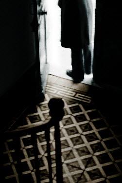 Douglas Black MAN STANDING IN DARK DOORWAY Men