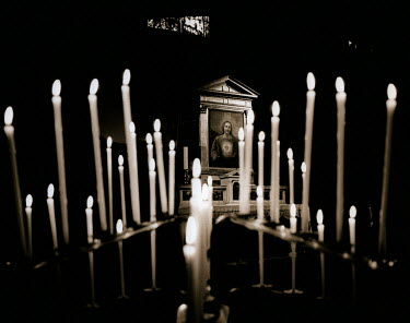 Andrew Davis CANDLES AND PICTURE IN CHURCH Religious Buildings