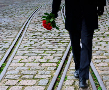 Helen Mayer MAN WALKING ALONG RAILWAY WITH ROSES Men