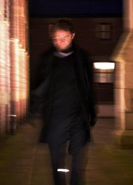 Helen Mayer MAN WALKING IN CITY AT NIGHT Men