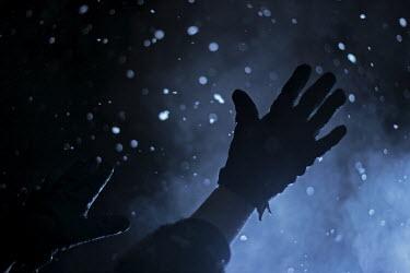 Myles Wickham GLOVED HANDS IN SNOW Body Detail