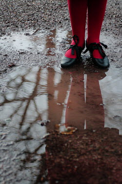 Myles Wickham WOMAN STANDING IN PUDDLE Body Detail