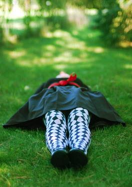 Elle Moss WOMAN LYING ON GRASS Women